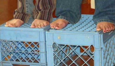 Feet standing on crates