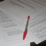 pages of lesson plans and a red pen