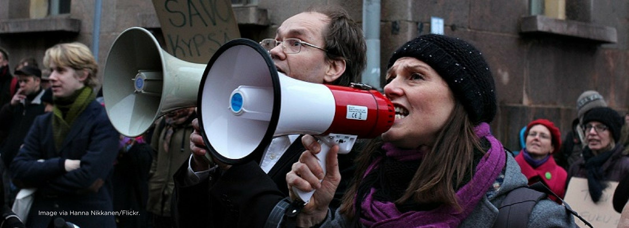 A group of protestors with two talking on megaphones