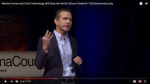 Screenshot of Bruce Friedrich giving TEDx talk about market forces and food technology