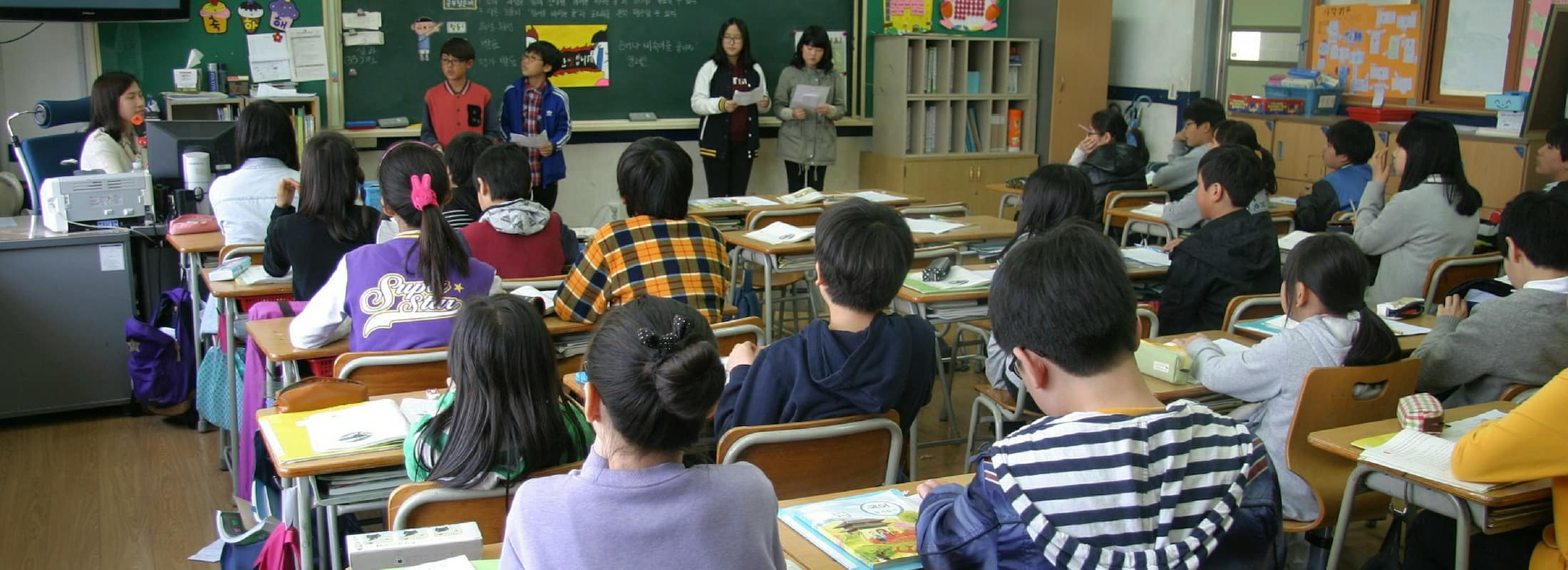 A classroom of students and their teacher